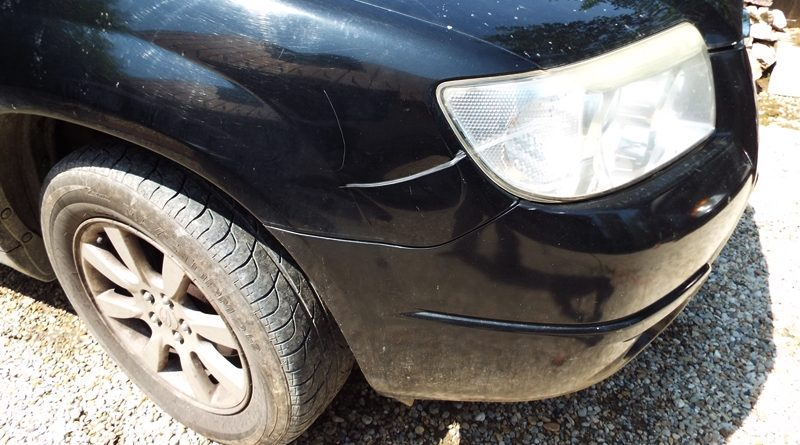 o mica avarie din parcare aripa fata Subaru Forester 0