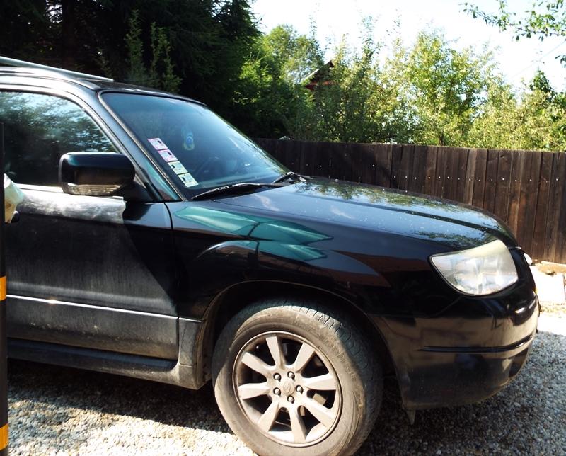 o mica avarie din parcare aripa fata Subaru Forester 1
